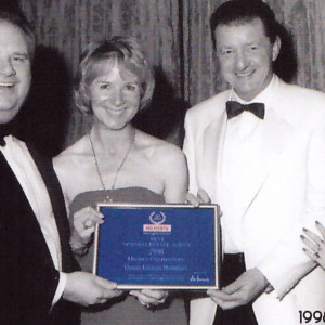 The Right Honourable Sir Eric Pickles MP, Alice Macdonald, Alasdair Macdonald, Helen Shields, House of Commons, London.  A-Team receiving award Air Harrods Best Spanish Estate Agent, Highly Commended 1998.
